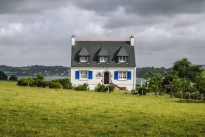 French Country house, white, in green field
